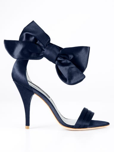 They get short shrift on Oscar night, shrouded as they are amid the evening's sartorial stars — the gowns. But formal style's second string — shoes, clutches and earrings — occupy pivotal red-carpet positions, too. USA TODAY's Olivia Barker pays respect to the pieces that all too often get overlooked. ('Jackie' bow sandals, on sale for $184.99 at AnnTaylor.com)