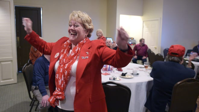 Cheryl Wilson of Franklin cheers when learning election results favoring Donald Trump at the Williamson County Republican watch party at Old Natchez Country Club in Franklin on Tuesday, Nov. 8, 2016.