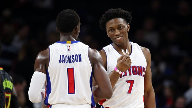 Jan 18, 2017; Auburn Hills, MI, USA; Pistons guard Reggie Jackson and teammate Stanley Johnson celebrate a 118-95 win over the Atlanta Hawks at the Palace.