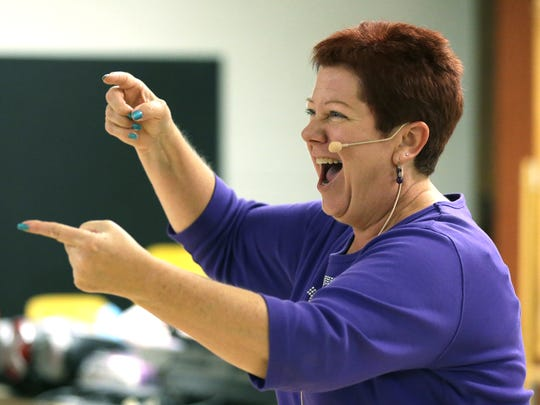 Fox Valley Chorus master director Heather Johnston of Milwaukee has fun leading the group during its weekly rehearsal Sept. 29 at Grace Lutheran Church in Appleton.