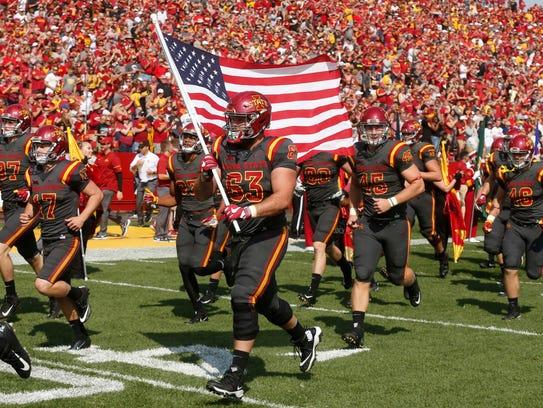 Iowa State senior Robby Garcia carries the United States