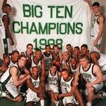 MSU players unfurl 2001 Big Ten Championship banner at Breslin Center.