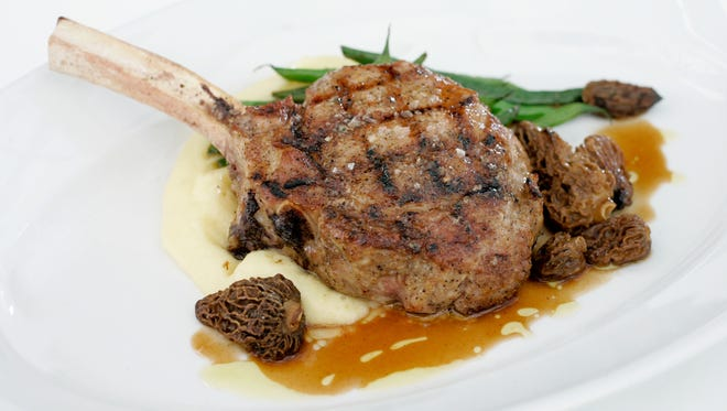 Strauss Farm Veal Rib Chop with ucon gold potato puree, morel mushrooms, spring beans, and house cured bacon from  Joseph Decuis, 191 North Main Street Roanoke Indiana.