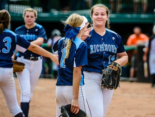 Richmond pitcher Erin Shuboy, right, smiles as she