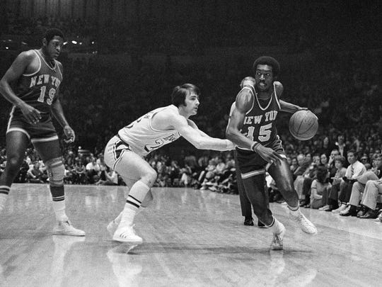 Earl Monroe dribbling around Gail Goodrich of the Los