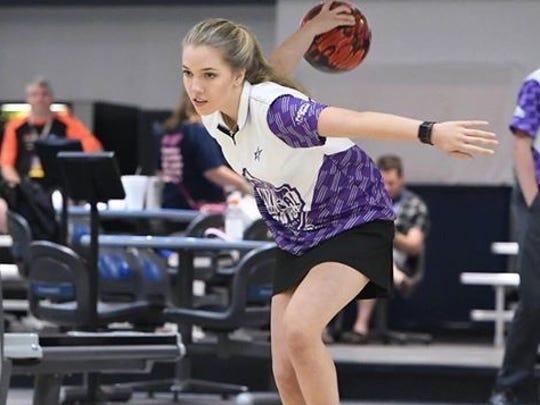 Campbell County sophomore Kaylee Hitt bowls a shot