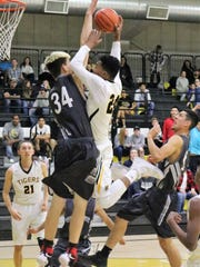 Alamogordo's Chamar Norman, right, tries to dunk over Chaparral's Dawson Roberts.