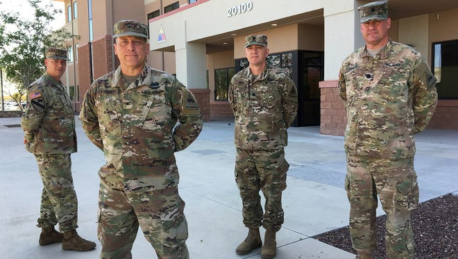 From left, Maj. Chris Sanders, Col. Kenneth Yeasky, Lt. Col. Kevin Gray and Lt. Col. Dave Lambert are serving as the rear detachment headquarters and staff for the 1st Armored Division Sustainment Brigade while the brigade has its headquarters deployed in Afghanistan. They are reservists from the 451st Expeditionary Sustainment Command from Wichita, Kan.
