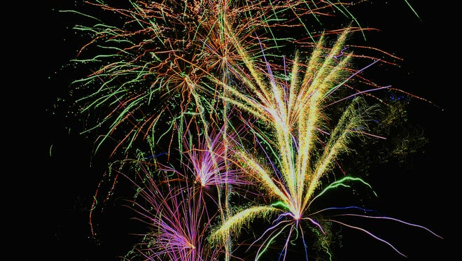 Fireworks explode in the sky over Mesilla as the town celebrates the Fourth of July.