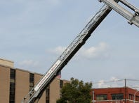 Four Campbellsville firefighters were injured when a ladder got too close to a power line.   ASSOCIATED PRESS A Campbellsville Fire Department truck with the ladder extended remained at the scene where two firefighters were injured during an ice bucket challenge during a fundraiser for ALS on Thursday, Aug. 21, 2014, in Campbellsville, Ky. Officials say the ladder got too close to a power line and electricity traveled to the ladder, electrocuting the firefighters. (AP Photo/Dylan Lovan)