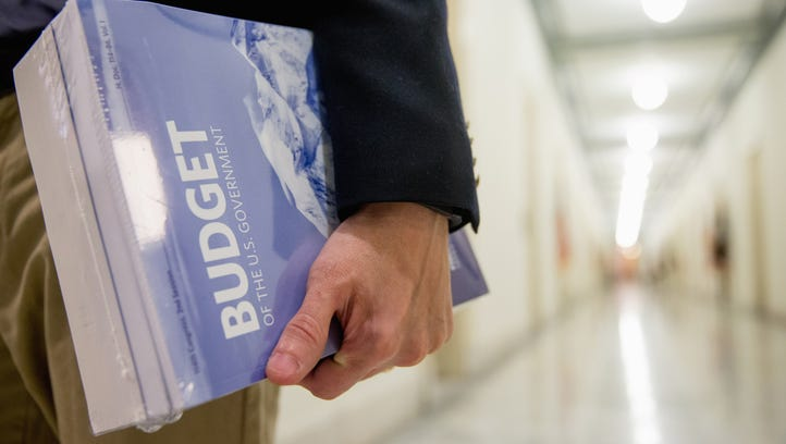 A Capitol Hill staffer holds a copy of President Obama's budget on Feb. 9, 2016.
