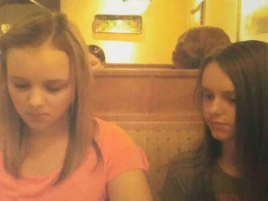 "Kurt Mills, not pictured, took this undated photograph of his daughter, Hannah Mills, left, while dining at an Olive Garden. He said this was the ""first time"" he saw his daughter after ""over a year"" because his ex-wife blocked his efforts."