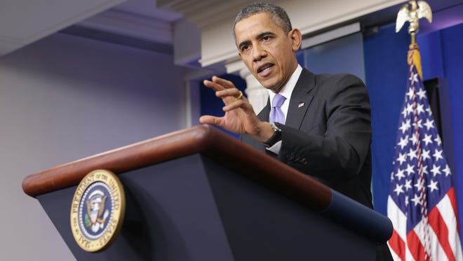 President Obama discusses the Affordable Care Act and the economy during a news conference Dec. 20 at the White House.