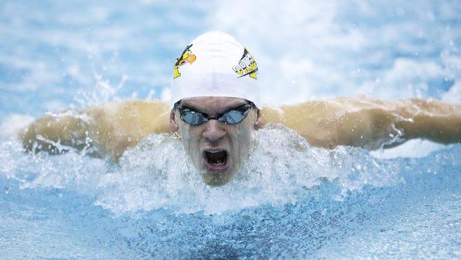 Chandler Bray, Avon High School, wins the men's butterfly with 51.69, during a swim meet pitting Center Grove at Avon High School, Avon, Tuesday, Dec 15, 2015.