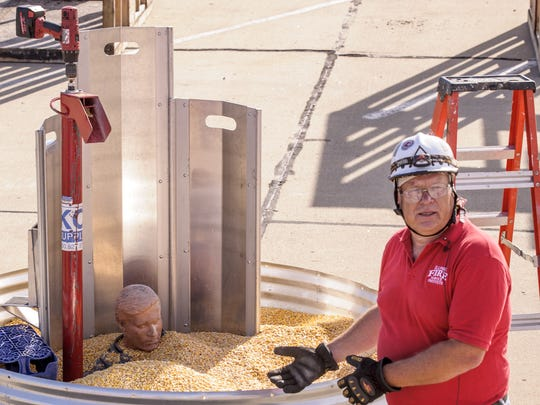 A safety official discusses a grain bin rescue during