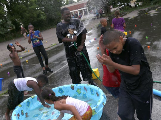 The fourth annual Oasis of Love Block Party, located on Bowman Street between Harker Street and Springmill Street is this Saturday, July 27.  In this picture from 2016, Patrick William Sr. sprays children in a water play area.