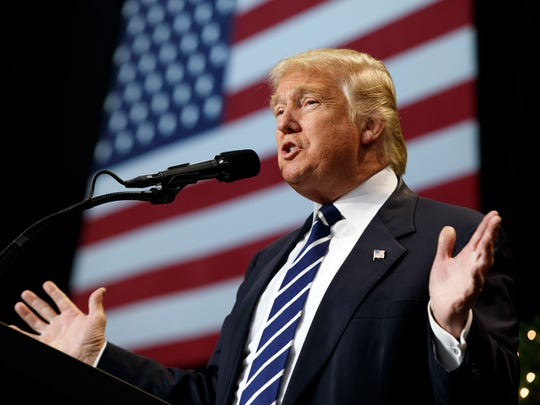 In this Dec. 13 photo, President-elect Donald Trump speaks during a rally at the Wisconsin State Fair Exposition Center. (AP Photo/Evan Vucci)