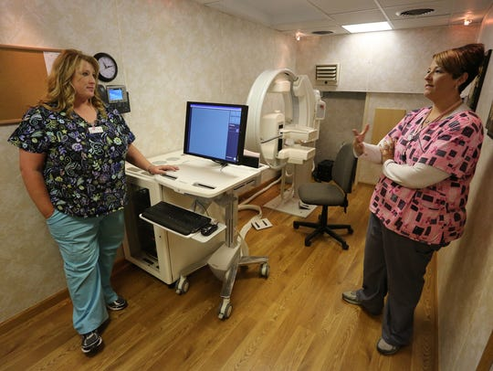 Lee Anne Ryta of Marshfield Clinic, right, explains