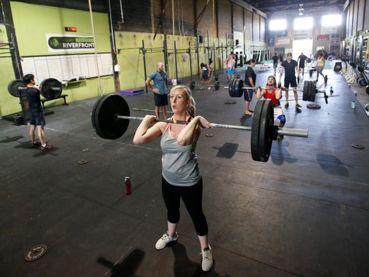Lauren Hester works out at CrossFit Riverfront Thursday. She gave birth to a daughter in April.