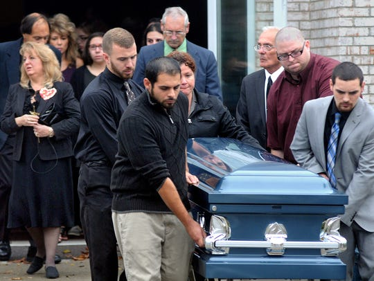 Matthew Byer, 26, of Wappingers Falls, is carried out