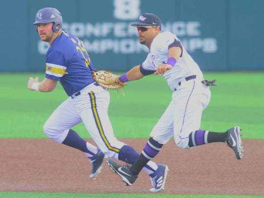 ACU first baseball Riley Donahue tags out Quinnipiac runner Liam Scafariello on a pickoff play in the first inning. ACU beat the Bobcats 10-9 in the season opener Friday, Feb. 16, 2018 at Crutcher Scott Field.
