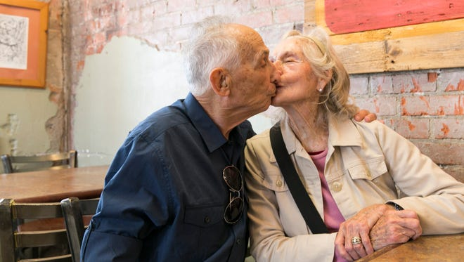 Sandy and Mary Oppenheimer, who worked in The Daily Advertiser building in 1950, kiss at Dwyer's while re-visiting Lafayette on April 13, 2016.