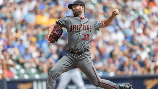 Arizona Diamondbacks starter Robbie Ray pitches to a Milwaukee Brewers batter during the first inning of a baseball game Thursday, July 28, 2016, in Milwaukee.