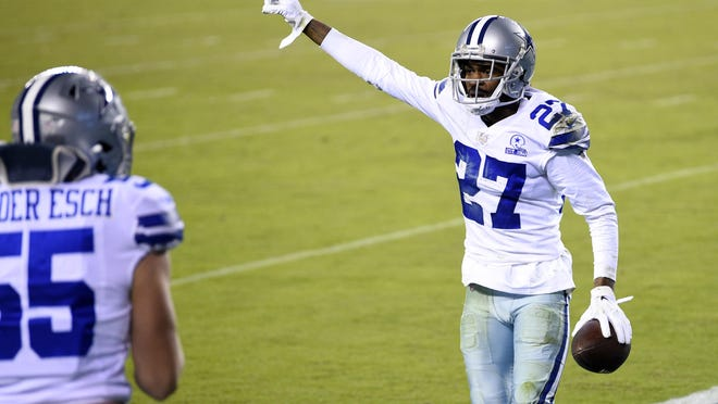 Dallas Cowboys' Trevon Diggs celebrates after intercepting a pass by Philadelphia Eagles' Carson Wentz during the Cowboys' 23-9 loss Monday. Diggs was one of a few bright spots for the Cowboys with two interceptions.