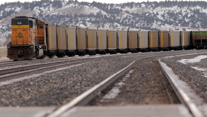 In this Nov. 22, 2014 photo, a long line of coal cars sits on a track near Rozet, Wyo. Mine executives from every company in the Powder River Basin have pointed to poor rail service limiting their ability to move coal from their mines to their utility customers. Missed shipments have added up to about 20 million tons of undelivered PRB coal. (AP Photo/Gillette News Record, Ed Glazar)