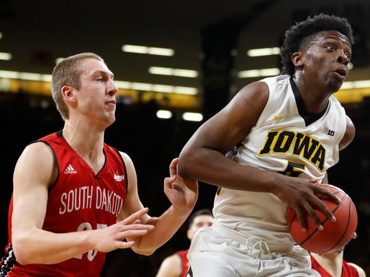 Iowa forward Tyler Cook drives to the basket past South Dakota forward Tyler Hagedorn, left, during the first half of a first-round game in the NIT college basketball tournament, Wednesday, March 15, 2017, in Iowa City, Iowa. (AP Photo/Charlie Neibergall)