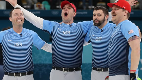 (L-R) Tyler George, skip John Shuster, John Landsteiner and Matt Hamilton of the US celebrate after winning the men's curling final between Sweden and USA during the PyeongChang Winter Olympic Games 2018.