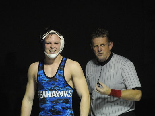 Stephen Decatur's Tyler VanSice smiles after winning a major decision in the 170-pound class.