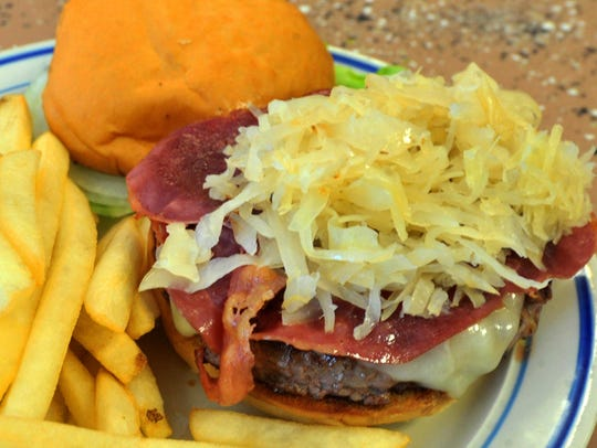 The Reuben burger prepared by The Diner Taqueria on