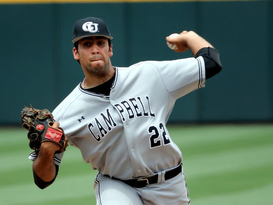 Campbell pitcher Hector Cedano (22) delivers a pitch during an NCAA college baseball tournament regional game against the Old Dominion in Columbia, S.C., Saturday, May 31, 2014. (AP Photo/Stephen B. Morton)