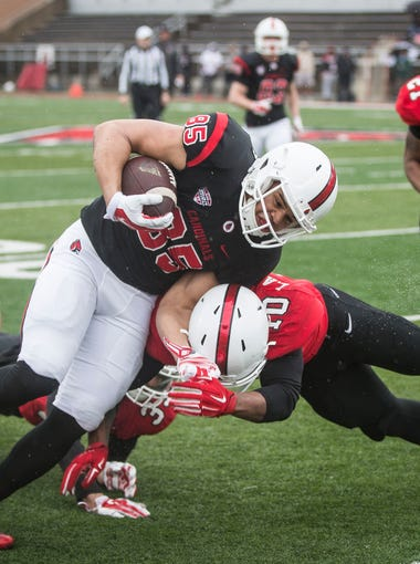 Ball State's Antwan Davis is tackled by Lamar Anderson during the annual spring game on April 14 at Scheumann Stadium.