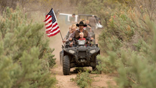 In this AP file photo, Ryan Bundy, son of the Nevada rancher Cliven Bundy, rides an ATV into Recapture Canyon north of Blanding. Phil Lyman was sentenced to 10 days in jail and $96,000 restitution for leading the ride.