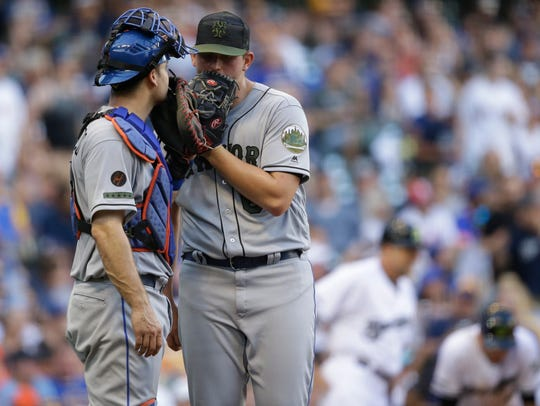 New York Mets pitcher Chris Flexen, right, talks with