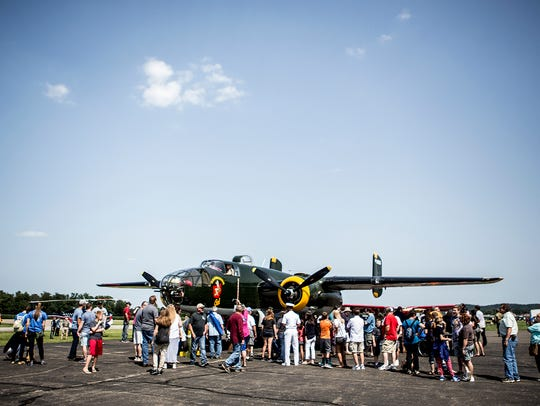 People line up to get a look inside a B-25 bomber at