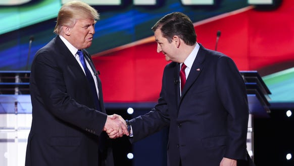 Ted Cruz shakes hands with Donald Trump before the