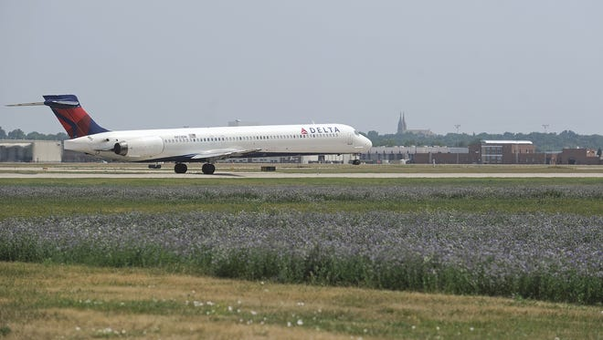 A Delta Air Lines jet takes off at the Sioux Falls Regional Airport in 2012.