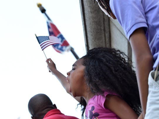 Hundreds Portested the Confederate flag in Columbia, S.C., last week, demanding its removal.