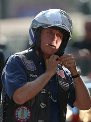 Indiana Gov. Mike Pence gets ready to lead the annual Governor's Motorcycle Ride with American Bikers Aimed Toward Education on Friday, July 29, 2016.
