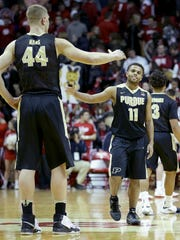 Purdue Boilermakers guard P.J. Thompson (11) begins to celebrate with Isaac Haas (44) in the second half of their game Thursday, February 9, 2017, evening at Assembly Hall in Bloomington IN. The Purdue Boilermakers defeated the Indiana Hoosiers 69-64.