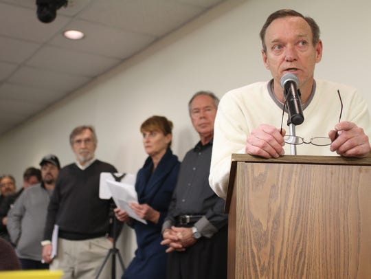 Brighton Township resident Mike Palmer addresses the
