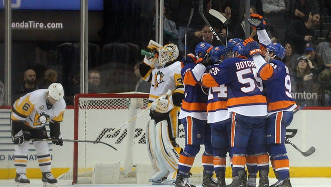The Islanders celebrate the game-winning goal by center Anders Lee at Barclays Center.