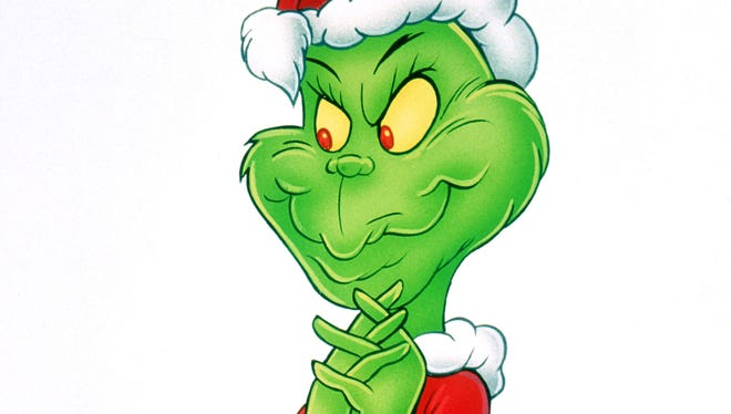 The Grinch, in a scene from How The Grinch Stole Christmas