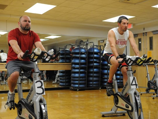 Detroit resident Mike Gumbel and Jon Rudd of Livonia take part in the cycling portion of the Arctic Chill Indoor Triathlon at the Livonia Recreation Center in this file photo.