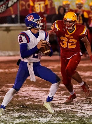 Reading All-State defensive lineman Brogan Wiler closes in on Lenawee Christian quarterback Adam Baker in last season's Division 8 Regional final. Wiler (32) had another outstanding season this year and is among the Rangers named All-State recently.