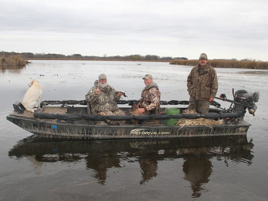 Ron Bergman (left) of Appleton holds a green-winged teal he shot Oct. 22 while hunting at Horicon Marsh with his son, Josh Bergman (center) of Chinquapin, North Carolina, and Chuck Dodge of Allenton. The hunt was part of activities organized by volunteers with Horicon Marsh Veterans Hunt Inc.