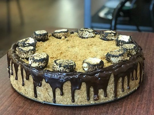 S'mores cheesecake -  marshmallow infused chocolate chip cheesecake topped with graham cracker crumbles, chocolate ganache drizzle and toasted marshmallows.